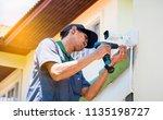 technician is installing... | Shutterstock . vector #1135198727