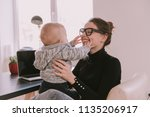 family  mother working with... | Shutterstock . vector #1135206917