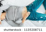 woman on bed with jeans and... | Shutterstock . vector #1135208711