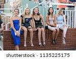 five well dressed girls sat on...   Shutterstock . vector #1135225175