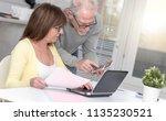 senior couple checking... | Shutterstock . vector #1135230521