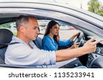 smiling woman learns to drive... | Shutterstock . vector #1135233941