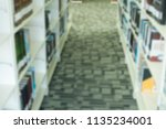 library with table desk and... | Shutterstock . vector #1135234001