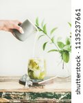 iced matcha latte drink in... | Shutterstock . vector #1135237661