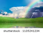 colorful rainbow in sky above... | Shutterstock . vector #1135241234