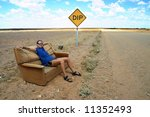 Woman Sitting And Resting On A...