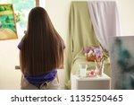 female student during classes... | Shutterstock . vector #1135250465