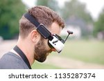 young man wearing fvp goggles.... | Shutterstock . vector #1135287374