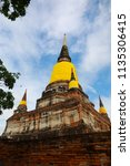 wat yai chai mongkhol in... | Shutterstock . vector #1135306415
