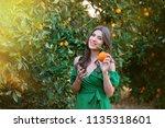 beautiful young woman  outdoors ... | Shutterstock . vector #1135318601