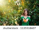 beautiful young woman  outdoors ... | Shutterstock . vector #1135318607