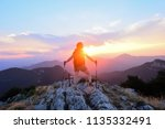 female hiker contemplating the... | Shutterstock . vector #1135332491