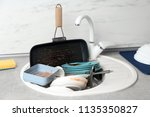 messy pile of dirty dishes in... | Shutterstock . vector #1135350827