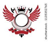 graphic winged emblem created... | Shutterstock .eps vector #1135352765