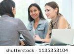 multicultural businesswomen... | Shutterstock . vector #1135353104