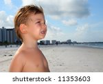 Kid on the beach - stock photo