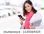 business woman using a... | Shutterstock . vector #1135369325