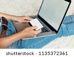 woman holding credit card and... | Shutterstock . vector #1135372361