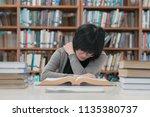 stressed asian student girl... | Shutterstock . vector #1135380737