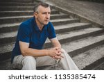 mature european man with a sad... | Shutterstock . vector #1135385474