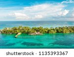 turquoise sea water and cloudy... | Shutterstock . vector #1135393367