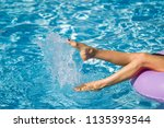 womans legs on the inflatable... | Shutterstock . vector #1135393544