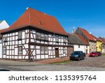 old house in historic... | Shutterstock . vector #1135395764