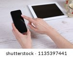 hand hold phone and touching on ...   Shutterstock . vector #1135397441
