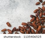dried dates on gray cement... | Shutterstock . vector #1135406525