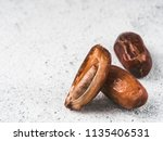 dried dates on gray cement... | Shutterstock . vector #1135406531
