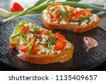 bruschetta with red sweet... | Shutterstock . vector #1135409657
