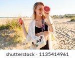 portrait of playful carefree...   Shutterstock . vector #1135414961