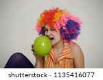 woman with colored afro wig... | Shutterstock . vector #1135416077