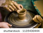 sculpts in clay pot closeup.... | Shutterstock . vector #1135430444