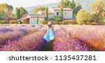 lovely girl dressing in blue... | Shutterstock . vector #1135437281