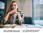 prosperous smiling female... | Shutterstock . vector #1135452347