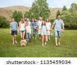 large family outdoors. mother ... | Shutterstock . vector #1135459034