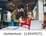 young work employee in... | Shutterstock . vector #1135459271