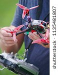 man holding racing drone in... | Shutterstock . vector #1135481807