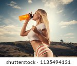 beautiful girl in sport clothes ... | Shutterstock . vector #1135494131