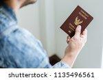 closeup of man holding... | Shutterstock . vector #1135496561