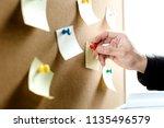 businessman putting his ideas... | Shutterstock . vector #1135496579