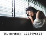 alone beautiful woman sitting... | Shutterstock . vector #1135496615