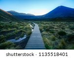 hiking the tongariro alpine... | Shutterstock . vector #1135518401
