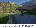 motorbike on the road riding.... | Shutterstock . vector #1135520435