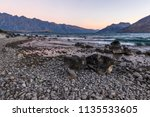 stony and rocky lake beach... | Shutterstock . vector #1135533605
