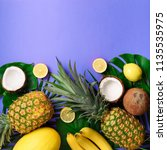exotic pineapples  coconuts ... | Shutterstock . vector #1135535975