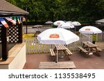 Small photo of 10th - July - 2018 - Staffordshire, A beer garden ins Staffordshire with Stella Artois umbrellas