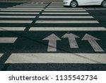 crosswalk and car. busy city... | Shutterstock . vector #1135542734