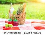 picnic basket  fruit  juice in... | Shutterstock . vector #1135570601